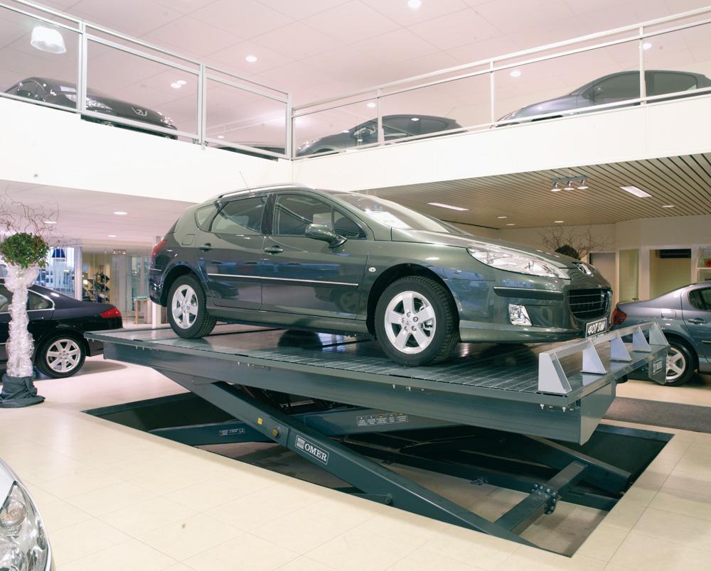 <p><strong>Garage Schyns Eupen - </strong>Peugeot</p><p>Schaarliftplatform waarmee voertuigen naar het verdiep van de toonzaal kunnen worden gebracht.</p>